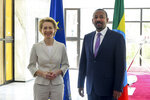 Newly elected President of the European Commission Ursula von der Leyen, left, meets with Ethiopia's Nobel Peace Prize winning Prime Minister, Abiy Ahmed, right, at the Prime Minister's office in the capital Addis Ababa, Ethiopia Saturday, Dec. 7, 2019. The new European Commission president says she chose Africa as her first visit outside Europe as it has some of the world's fastest-growing economies and some of its biggest challenges including climate change. (AP Photo)