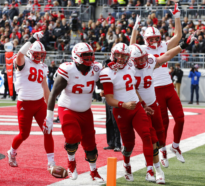 Nebraska players celebrate a touchdown against Ohio State during the first half of an NCAA college football game Saturday, Nov. 3, 2018, in Columbus, Ohio. (AP Photo/Jay LaPrete)