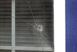 In this Oct. 15, 2019, photo, a bullet hole is seen in a window in the home of Atatiana Jefferson in Fort Worth, Texas. Residents of Jefferson's Fort Worth neighborhood said they were hesitant to dial 911 before a white officer shot her through a bedroom window Saturday. Now, some in the mostly black and Hispanic area feel calling law enforcement is too dangerous. (AP Photo/Tony Gutierrez)
