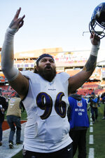 Baltimore Ravens nose tackle Domata Sr. Peko celebrates after the Ravens defeated the Cleveland Browns in an NFL football game, Sunday, Dec. 22, 2019, in Cleveland. (AP Photo/Ron Schwane)