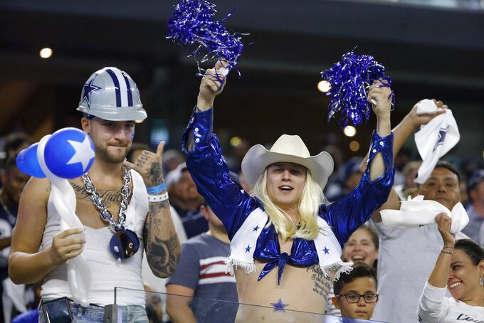 Dallas Cowboys fans cheer in the second half of an NFL football game against the Philadelphia Eagles in Arlington, Texas, Monday, Sept. 27, 2021. (AP Photo/Ron Jenkins)