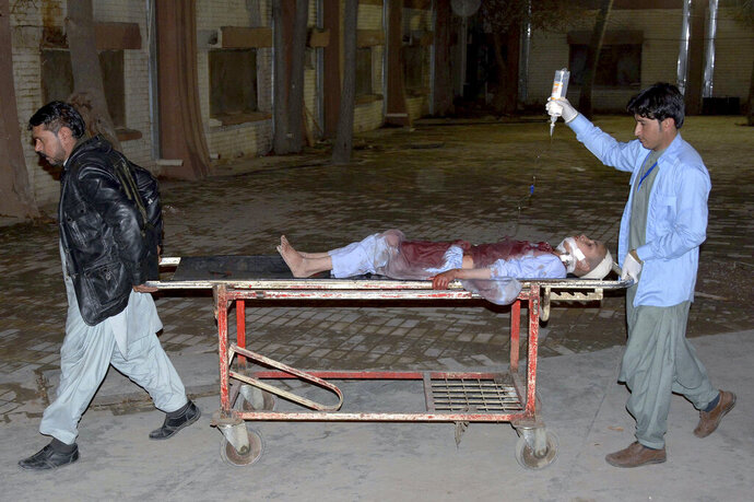 A boy, who was injured in the mosque bombing, is transported at a hospital in Quetta, Pakistan, Friday, Jan. 10, 2020. A powerful explosion ripped through a mosque in southwest Pakistan during Friday evening prayers, killing a senior police officer with some civilians and wounded other worshipers, police said. (AP Photo/Arshad Butt)