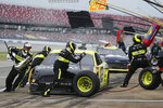 Ryan Blaney (12) gets service in the pits during a NASCAR Cup Series auto race at Talladega Superspeedway in Talladega Ala., Monday, June 22, 2020. (AP Photo/John Bazemore)