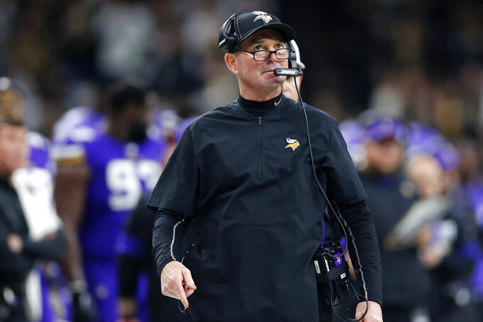 Minnesota Vikings head coach Mike Zimmer walks on the sideline in the first half of an NFL wild-card playoff football game against the New Orleans Saints, Sunday, Jan. 5, 2020, in New Orleans. (AP Photo/Brett Duke)