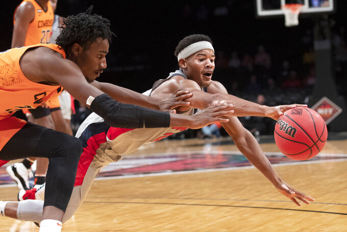 Mississippi guard Devontae Shuler, right, and Oklahoma State forward Kalib Boone dive for a loose ball during the second half of an NCAA college basketball game in the final of the NIT Season Tip-Off tournament, Friday, Nov. 29, 2019, in New York. Oklahoma State won 78-37. (AP Photo/Mary Altaffer)