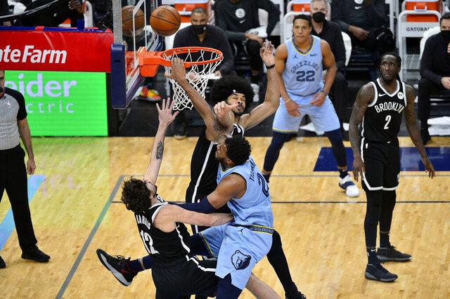 Memphis Grizzlies forward Xavier Tillman (2) shoots between Brooklyn Nets guard Joe Harris (12) and center Jarrett Allen (31) during the second half of an NBA basketball game Friday, Jan. 8, 2021, in Memphis, Tenn. (AP Photo/Brandon Dill)