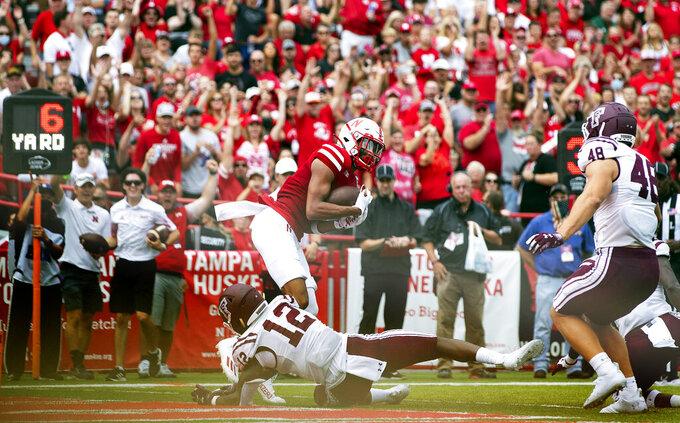 Nebraska's Samori Toure scores a touchdown against Fordham's Natani Drati (12) during the second half of an NCAA college football game Saturday, Sept. 4, 2021, at Memorial Stadium in Lincoln, Neb. (AP Photo/Rebecca S. Gratz)