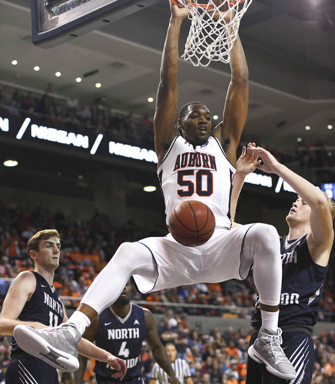 Auburn center Austin Wiley (50) dunks against North Florida during the second half of an NCAA college basketball game Saturday, Dec. 29, 2018, in Auburn, Ala. (AP Photo/Julie Bennett)
