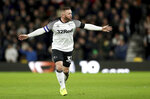 Derby County's Wayne Rooney gestures to his team-mates during the match against Barnsley, during their English Championship soccer match at Pride Park in Derby, England, Thursday Jan. 2, 2020. (Bradley Collyer/PA via AP)
