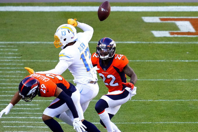 Denver Broncos cornerback Bryce Callahan (29) breaks up a pass intended for Los Angeles Chargers wide receiver Keenan Allen (13) as strong safety Kareem Jackson (22) looks on during the first half of an NFL football game, Sunday, Nov. 1, 2020, in Denver. (AP Photo/Jack Dempsey)