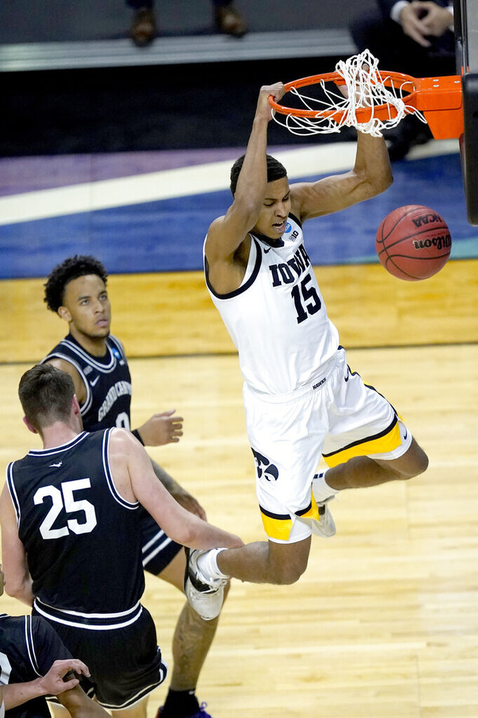 Iowa's Keegan Murray (15) dunks the ball past Grand Canyon's Alessandro Lever (25) during the first half of a first round NCAA college basketball tournament game Saturday, March 20, 2021, at the Indiana Farmers Coliseum in Indianapolis. (AP Photo/Charles Rex Arbogast)
