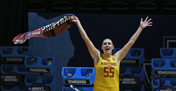 Maryland forward Chloe Bibby (55) cheers as the clock winds down in game against Alabama during the second half of a college basketball game in the second round of the women's NCAA tournament at the Greehey Arena in San Antonio on Wednesday, March 24, 2021. Maryland defeated Alabama 100-64. (AP Photo/Ronald Cortes)