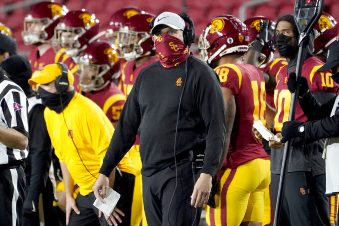 Southern California head coach Clay Helton looks up from the sideline during the second half of an NCAA college football game against Washington State in Los Angeles, Sunday, Dec. 6, 2020. (AP Photo/Alex Gallardo)