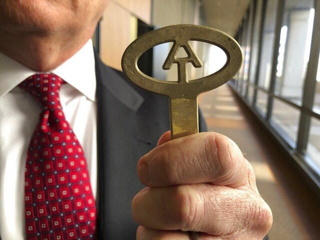 South Carolina Corrections Department Director Bryan Stirling holds up a key that can lock and unlock every cell in a wing of a state prison after a hearing on Wednesday, Jan. 22, 2020, in Columbia, South Carolina. Stirling is asking for more than $100 million in his next budget to add electronic locks to all his cells among other security upgrades (AP Photo/Jeffrey Collins)