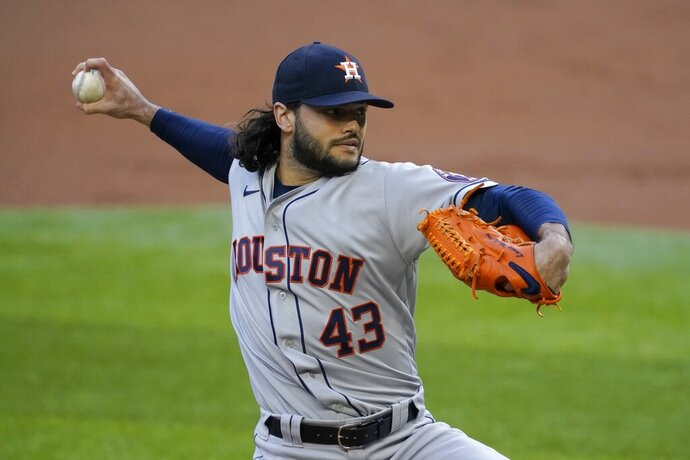 Houston Astros starting pitcher Lance McCullers Jr. throws to the Texas Rangers in the first inning of a baseball game in Arlington, Texas, Saturday, Sept. 26, 2020. (AP Photo/Tony Gutierrez)