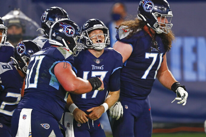 Tennessee Titans quarterback Ryan Tannehill (17) celebrates after scoring a touchdown on a 10-yard run against the Buffalo Bills in the first half of an NFL football game Tuesday, Oct. 13, 2020, in Nashville, Tenn. (AP Photo/Wade Payne)