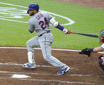 New York Mets Robinson Cano watches a two-run single against the Atlanta Braves during the third inning of a baseball game Monday, Aug. 3, 2020, in Atlanta. (Curtis Compton/Atlanta Journal-Constitution via AP)