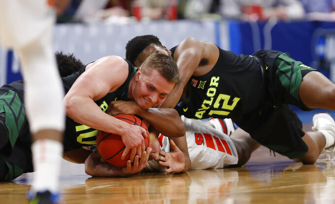 Baylor guardsMakai Mason (10) and Jared Butler (12) battle for the loose ball against Syracuse forward Elijah Hughes during the first half of a first-round game in the NCAA men's college basketball tournament Thursday, March 21, 2019, in Salt Lake City. (AP Photo/Jeff Swinger)