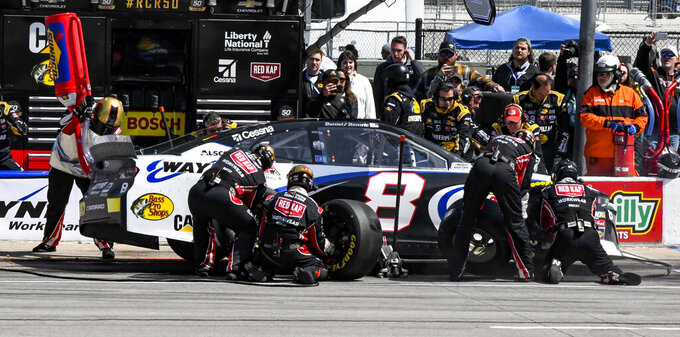 Driver Daniel Hemric's pit crew service his car during a NASCAR Cup auto race at Texas Motor Speedway, Sunday, March 31, 2019, in Fort Worth, Texas. (AP Photo/Larry Papke)