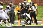 Missouri running back Tyler Badie, front right, scores a touchdown in front of Central Michigan's Alonzo McCoy (3) and Devonni Reed during the first half of an NCAA college football game Saturday, Sept. 4, 2021, in Columbia, Mo. (AP Photo/L.G. Patterson)