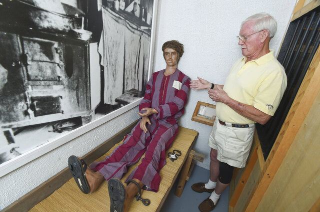 In this undated photo, Ed Hubbard stands inside a display at the Air Force Armament Museum in Fort Walton Beach, Fla., as he talks about what it was like to be a prisoner of war at the infamous Hanoi Hilton prison during the Vietnam War. With a special invitation from Commissioner Roger Goodell, the 81-year-old Hubbard will be in Hard Rock Stadium on Sunday night to watch his Kansas City Chiefs play the San Francisco 49ers in its first Super Bowl appearance in 50 years. (Devon Ravine/Northwest Florida Daily News via AP)