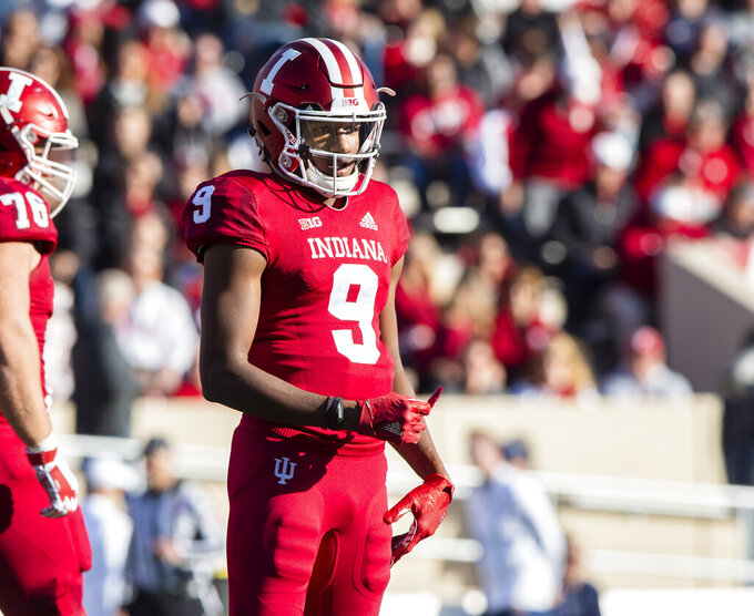 FILE - In this Oct. 20, 2018, file photo, Indiana quarterback Michael Penix Jr. (9) looks to the sideline during the first half of an NCAA college football game, in Bloomington, Ind. Peyton Ramsey will battle Penix and Jack Tuttle for the starting quarterback job. (AP Photo/Doug McSchooler, File)