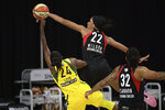 Las Vegas Aces center A'ja Wilson (22) blocks a shot by Seattle Storm guard Jewell Loyd (24) as Aces forward Emma Cannon (32) watches during the first half of Game 2 of basketball's WNBA Finals, Sunday, Oct. 4, 2020, in Bradenton, Fla. (AP Photo/Phelan M. Ebenhack)
