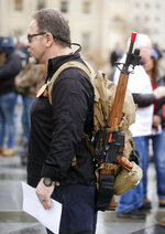Terry Santure, of Norfolk, Va., carries an AR-style firearm during a gun rights rally at the State Capitol in Richmond, Va., on Monday, Dec. 9, 2019. (Joe Mahoney/Richmond Times-Dispatch via AP)