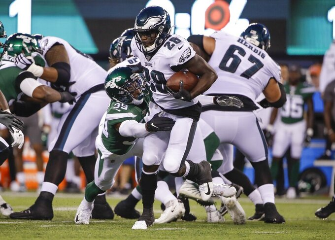 New York Jets' Sojourn Shelton (39) tackles Philadelphia Eagles' Wendell Smallwood (28) during the first half of a preseason NFL football game Thursday, Aug. 29, 2019, in East Rutherford, N.J. (AP Photo/Matt Rourke)