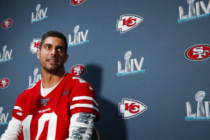 San Francisco 49ers quarterback Jimmy Garoppolo speaks during a media availability Wednesday, Jan. 29, 2020, in Miami, for the team's NFL Super Bowl 54 football game against the Kansas City Chiefs. (AP Photo/Wilfredo Lee)