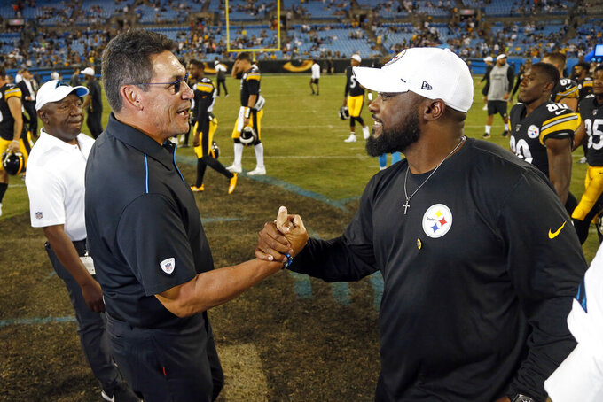 Carolina Panthers head coach Ron Rivera, left, and Pittsburgh Steelers head coach Mike Tomlin shake hands following the Panthers 25-19 win over the Steelers following an NFL preseason football game in Charlotte, N.C., Thursday, Aug. 29, 2019. (AP Photo/Brian Blanco)