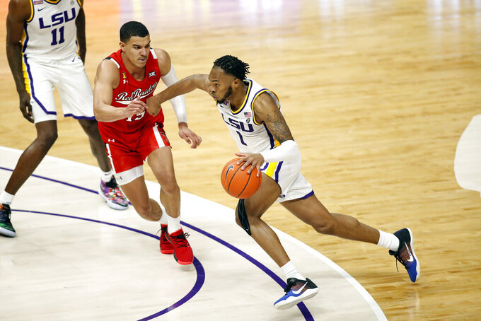 LSU guard Ja'Vonte Smart (1) drives past Texas Tech guard Kevin McCullar (15) in the second half of an NCAA college basketball game in Baton Rouge, Saturday, Jan. 30, 2021. (AP Photo/Tyler Kaufman)