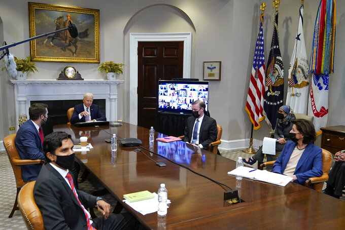 President Joe Biden participates virtually in the CEO Summit on Semiconductor and Supply Chain Resilience in the Roosevelt Room of the White House, Monday, April 12, 2021, in Washington. Seated with Biden are Daleep Singh, Deputy National Security Adviser and Deputy Director of the National Economic Council, clockwise from bottom left, National Economic Council Director Brian Deese, National Security Adviser Jake Sullivan and Commerce Secretary Gina Raimondo. (AP Photo/Patrick Semansky)