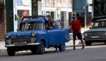 A drives pushes his vehicle to a gas station in Havana, Cuba, Thursday, Sept. 19, 2019. Increasingly, gas stations are running out with people still waiting in line. Drivers have started lining up outside empty gas stations in the hope that a truck from the state-run fuel monopoly will come by to fill its pumps. (AP Photo/Ismael Francisco)