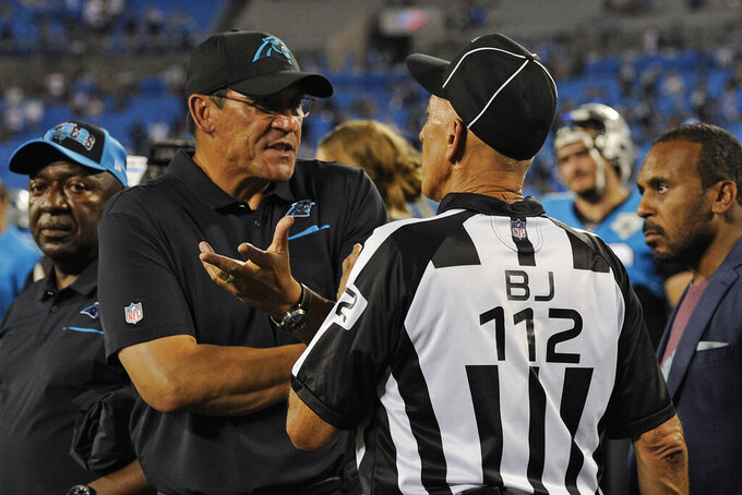 Carolina Panthers head coach Ron Rivera argues with an official following an NFL football game against the Tampa Bay Buccaneers in Charlotte, N.C., Friday, Sept. 13, 2019. (AP Photo/Mike McCarn)