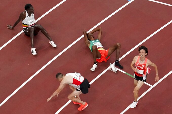 Tatsuhiko Ito, of Japan, reacts after running in the men's 10,000-meter finals at the 2020 Summer Olympics, Friday, July 30, 2021, in Tokyo. (AP Photo/Morry Gash)