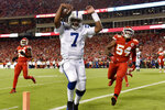 Indianapolis Colts quarterback Jacoby Brissett (7) scores a touchdown next to Kansas City Chiefs linebacker Damien Wilson (54) during the first half of an NFL football game in Kansas City, Mo., Sunday, Oct. 6, 2019. (AP Photo/Ed Zurga)