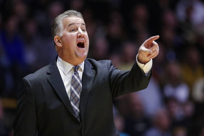 Purdue head coach Matt Painter gestures during the first half of an NCAA college basketball game against Rutgers in West Lafayette, Ind., Saturday, March 7, 2020. (AP Photo/Michael Conroy)