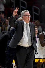 Iowa coach Fran McCaffery gestures to the team during the first half of an NCAA college basketball game against Cincinnati, Saturday, Dec. 21, 2019, in Chicago. (AP Photo/Matt Marton)