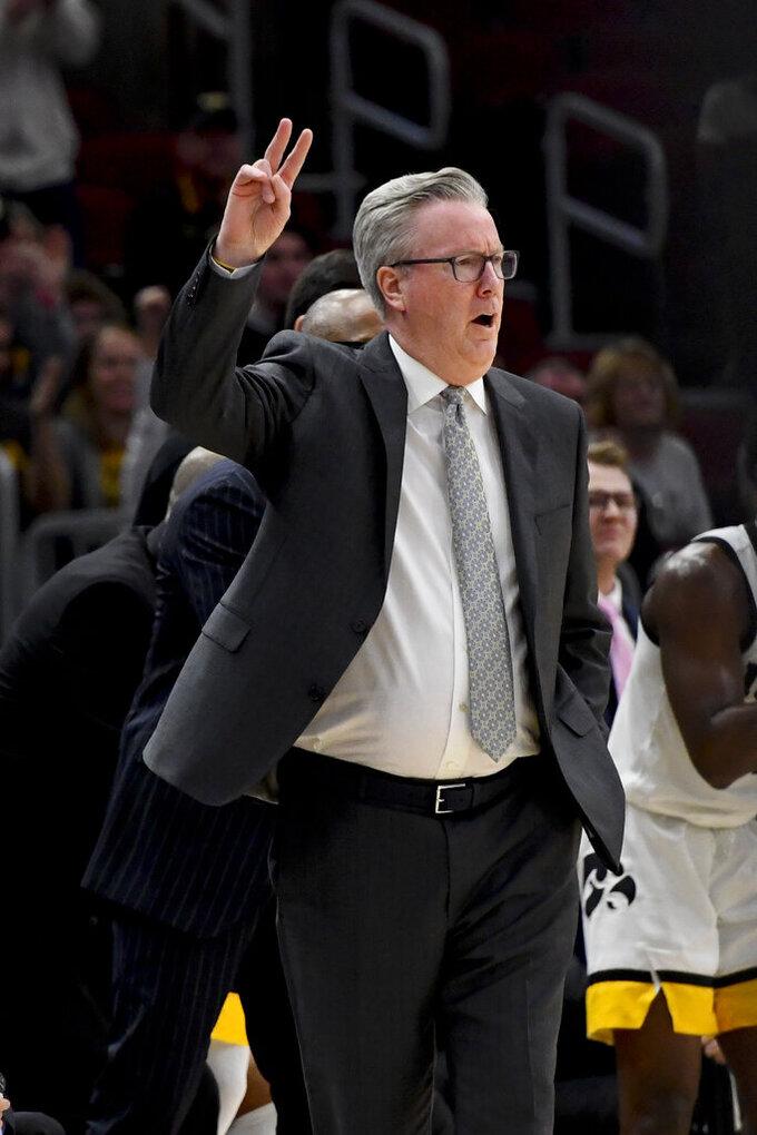 Iowa coach Fran McCaffery gestures to the team during the first half of an NCAA college basketball game against Cincinnati, Saturday, Dec. 21, 2019, in Chicago. (AP Photo/Matt Marton)