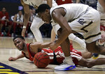 Washington State's Marvin Cannon, left, and California's Paris Austin reach for the ball in the second half of an NCAA college basketball game Saturday, March 2, 2019, in Berkeley, Calif. (AP Photo/Ben Margot)