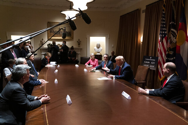 President Donald Trump speaks during a meeting with North Dakota Gov. Doug Burgum and Colorado Gov. Jared Polis on the coronavirus response, in the Cabinet Room of the White House, Wednesday, May 13, 2020, in Washington. (AP Photo/Evan Vucci)