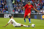 United States' Tobin Heath, right, dribbles past Portugal's Ana Borges during the first half of a friendly soccer match Tuesday, Sept. 3, 2019, in St. Paul, Minn. (AP Photo/Bruce Kluckhohn)
