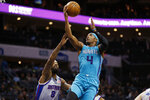 Charlotte Hornets guard Devonte' Graham, right, drives to the basket against Detroit Pistons forward Markieff Morris during the first half of an NBA basketball game in Charlotte, N.C., Friday, Nov. 15, 2019. (AP Photo/Nell Redmond)