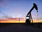FILE - This April 8, 2020 file photo shows a pump jack near Hobbs, N.M. New Mexico is now the nation's second largest oil producing state, and environmental regulators say more needs to be done to rein in pollution from the industry. (Blake Ovard/The Hobbs Daily News-Sun via AP, File)