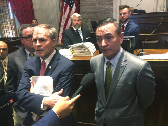 House Speaker Glen Casada, right, speaks to reporters on the House floor in Nashville, Tenn. on Tuesday, April 23, 2019. An already contentious voucher-like proposal took a dramatic turn in Tennessee on Tuesday as Republican leaders refused to acknowledge a vote spiking the proposal on the House floor and Senate leaders advocated for a drastically different version. (AP Photo/Kimberlee Kruesi)
