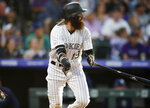 Colorado Rockies' Charlie Blackmon watches his RBI double off San Diego Padres starting pitcher Eric Lauer during the third inning of a baseball game Saturday, June 15, 2019, in Denver. (AP Photo/David Zalubowski)