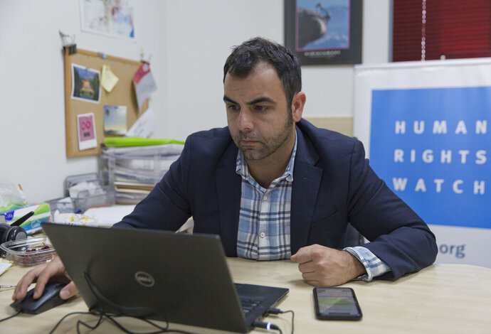 Omar Shakir, the local director of Human Rights Watch, works at his office in the West Bank city of Ramallah, Tuesday, Nov. 5, 2019. Israel's Supreme Court on Tuesday rejected an appeal by Shakir, which sought to block the Israeli government's attempt to expel him for allegedly supporting an international boycott movement against Israel. (AP Photo/Nasser Nasser)