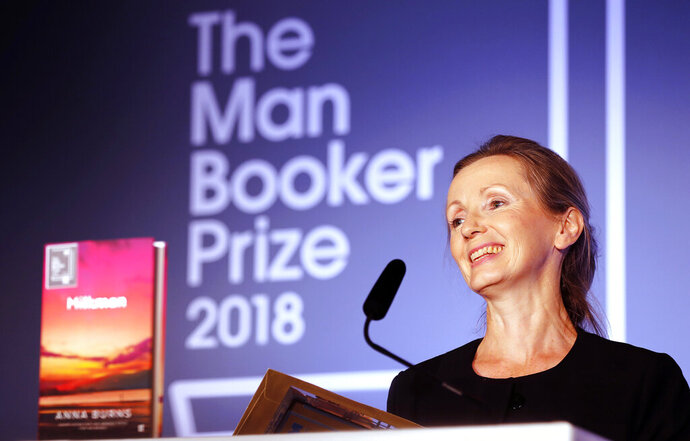 FILE - In this Oct. 16, 2018 file photo, author Anna Burns smiles after being presented with the Man Booker Prize for Fiction 2018 for