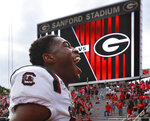 South Carolina defensive back Israel Mukuamu celebrates their 20-17 double overtime win over No. 3 Georgia in an NCAA college football game on Saturday, Oct. 12, 2019, in Athens, Ga.(Curtis Compton/Atlanta Journal-Constitution via AP)